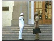 Antwone Fisher Movie Still:  Antwone (Derek Luke) and Dr. Davenport (Denzel Washington) salute one another.