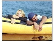 Swept Away movie still: Amber (Madonna) finds herself adrift helplessly at sea with Giuseppe (Adriano Gianinni) in Swept Away