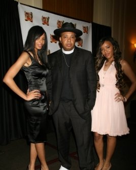 Reverend Run with his daughters Vanessa and Angela