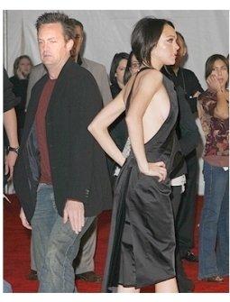General Motors Annual ten Event Photos: Matthew Perry tries to sneek by Lindsay Lohan