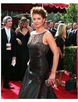 Debra Messing on the red carpet at the 57th Annual Primetime Emmy Awards