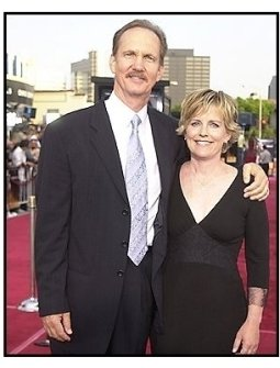 """Michael O'Neill and date at the """"Seabiscuit"""" premiere"""